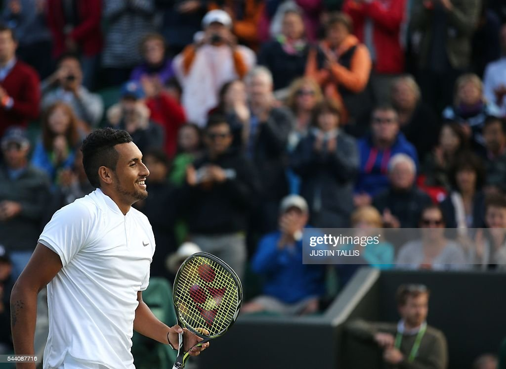 Australia's Nick Kyrgios celebrates beating Germany's Dustin Brown during their men's singles second round match on the fifth day of the 2016 Wimbledon Championships at The All England Lawn Tennis Club in Wimbledon, southwest London, on July 1, 2016. / AFP / JUSTIN