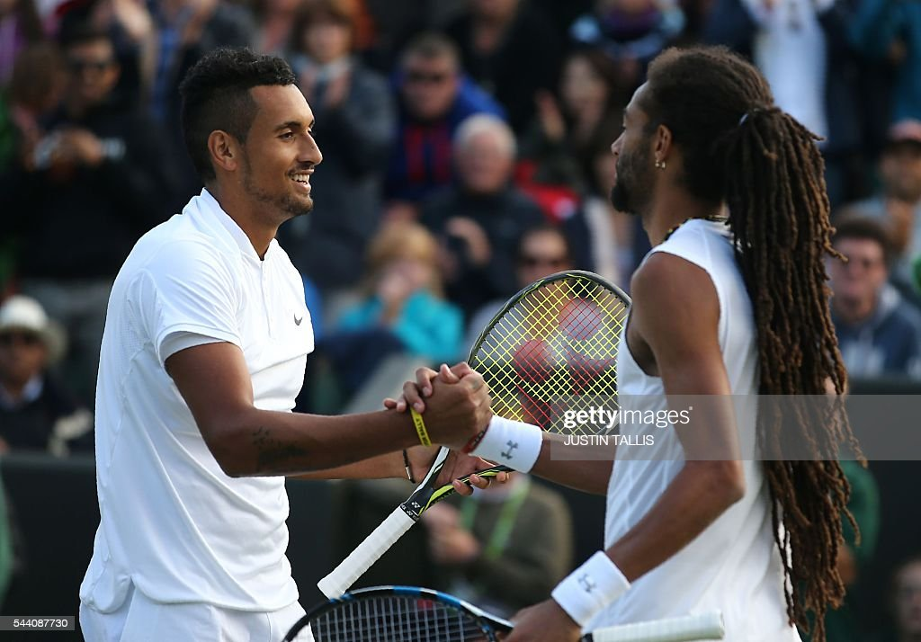 Australia's Nick Kyrgios (L) celebrates beating Germany's Dustin Brown during their men's singles second round match on the fifth day of the 2016 Wimbledon Championships at The All England Lawn Tennis Club in Wimbledon, southwest London, on July 1, 2016. / AFP / JUSTIN