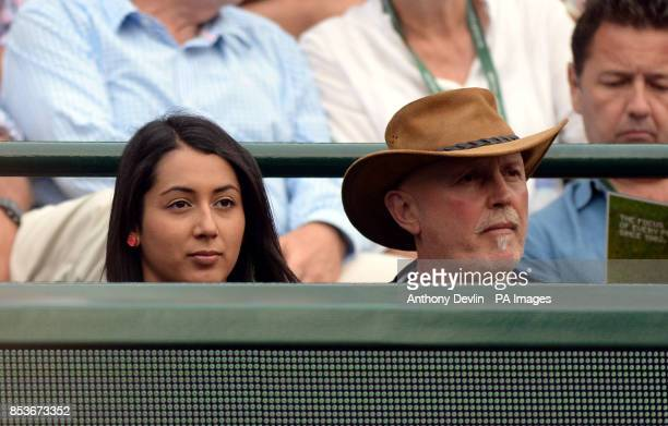 Australia's Nick Kyrgios' father and sister George and Halimah watch his match against Canada's Milos Raonic during day ten of the Wimbledon...