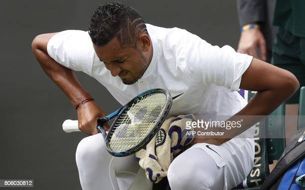 Australia's Nick Kyrgios grimaces during a break in play against France's PierreHugues Herbert during their men's singles first round match on the...