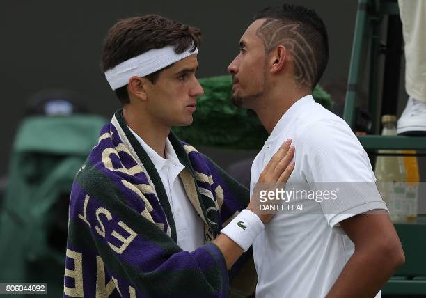 CORRECTION Australia's Nick Kyrgios is consoled by France's PierreHugues Herbert after retiring from their men's singles first round match on the...