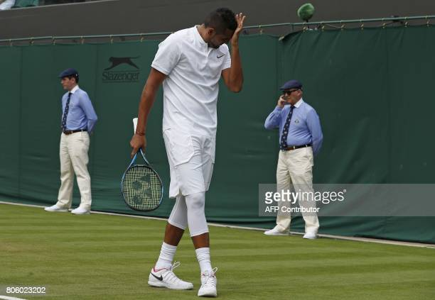 Australia's Nick Kyrgios reacts against France's PierreHugues Herbert during their men's singles first round match on the first day of the 2017...