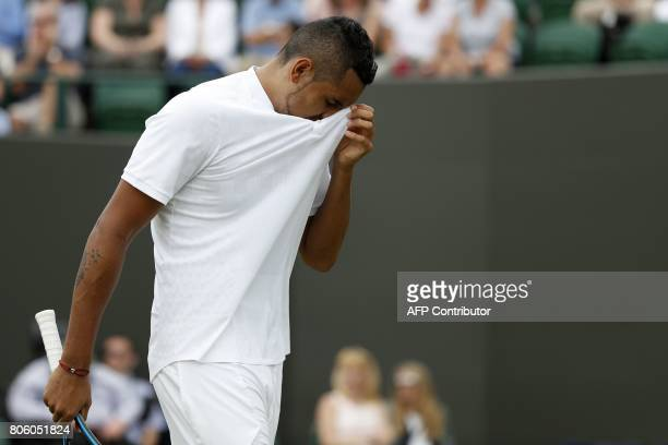 Australia's Nick Kyrgios reacts against France's PierreHugues Herbert before retiring from their men's singles first round match on the first day of...