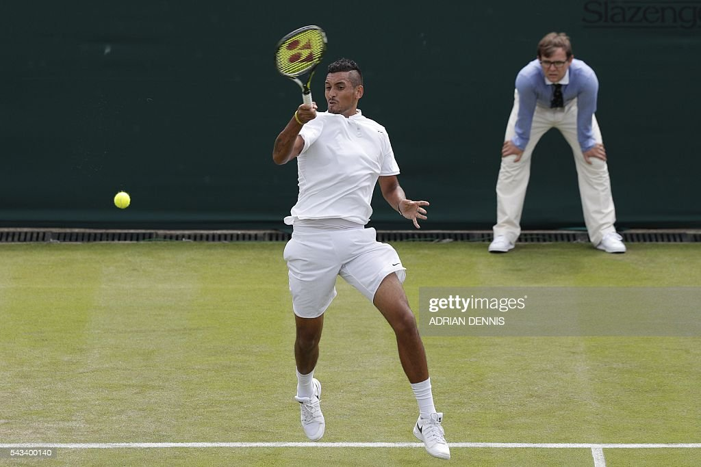 Australia's Nick Kyrgios returns against Czech Republic's Radek Stepanek during their men's singles first round match on the second day of the 2016 Wimbledon Championships at The All England Lawn Tennis Club in Wimbledon, southwest London, on June 28, 2016. / AFP / ADRIAN