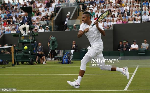 Australia's Nick Kyrgios returns against France's PierreHugues Herbert during their men's singles first round match on the first day of the 2017...