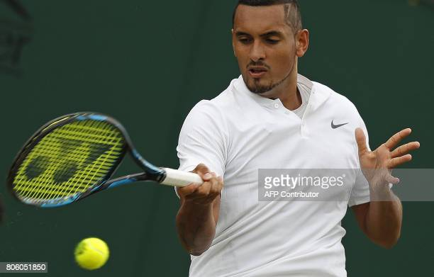 Australia's Nick Kyrgios returns against France's PierreHugues Herbert before retiring from their men's singles first round match on the first day of...