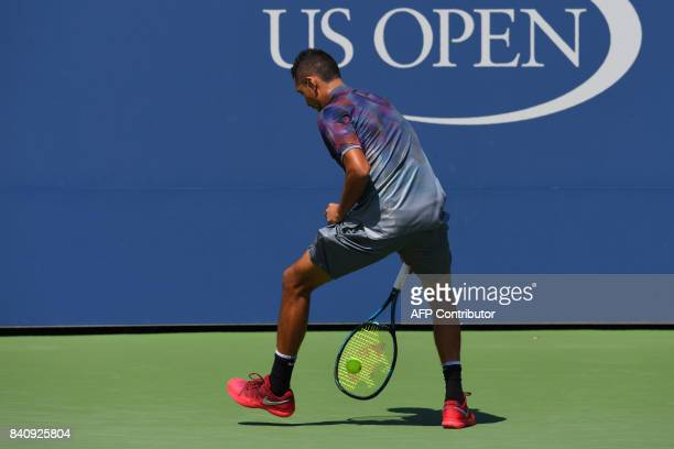 Australia's Nick Kyrgios returns the ball to Australia's John Millman during their Qualifying Men's Singles match at the 2017 US Open Tennis...