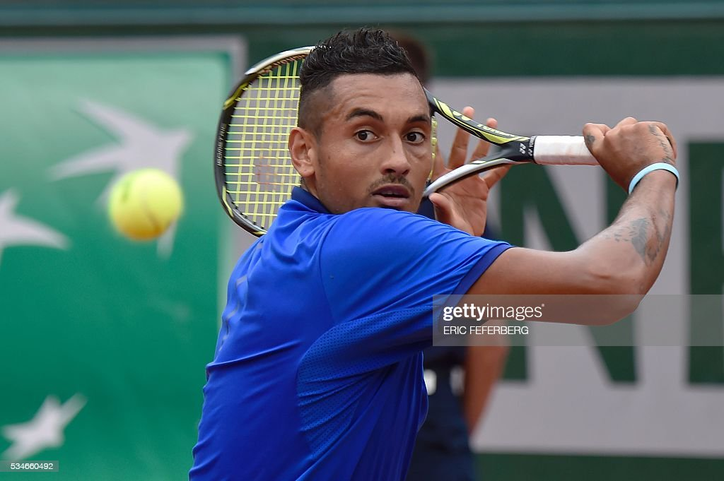 Australia's Nick Kyrgios returns the ball to Rrance's Richard Gasquet during their men's third round match at the Roland Garros 2016 French Tennis Open in Paris on May 27, 2016. / AFP / Eric FEFERBERG