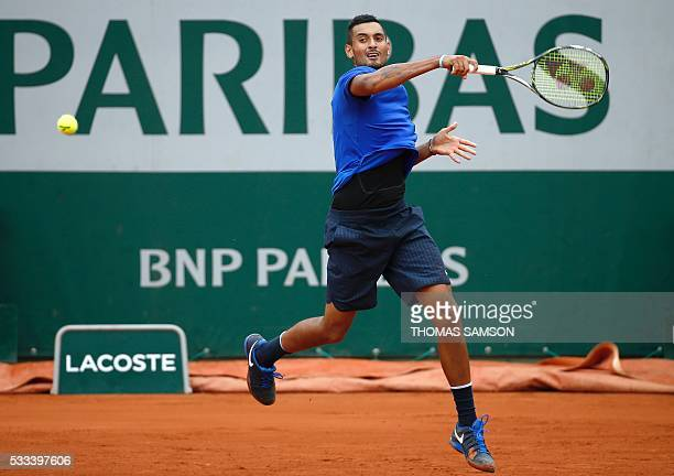 Australia's Nick Kyrgios returns the ball to Italy's Marco Cecchinato during their men's first round match at the Roland Garros 2016 French Tennis...