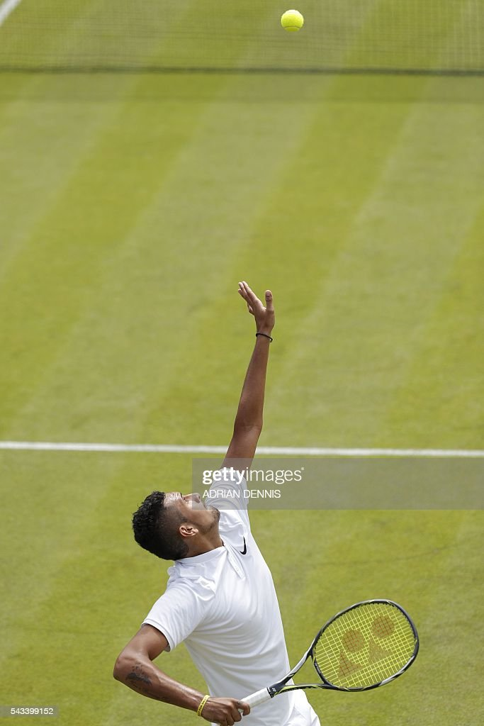 Australia's Nick Kyrgios serves against Czech Republic's Radek Stepanek during their men's singles first round match on the second day of the 2016 Wimbledon Championships at The All England Lawn Tennis Club in Wimbledon, southwest London, on June 28, 2016. / AFP / ADRIAN