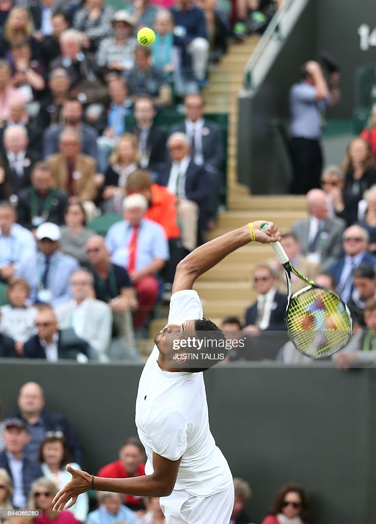 Australia's Nick Kyrgios serves to Germany's Dustin Brown during their men's singles second round match on the fifth day of the 2016 Wimbledon Championships at The All England Lawn Tennis Club in Wimbledon, southwest London, on July 1, 2016. / AFP / JUSTIN