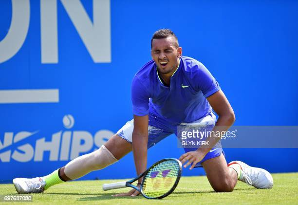 TOPSHOT Australia's Nick Kyrgios slips during his men's singles 1st round match against Donald Young of the US at the ATP Aegon Championships tennis...