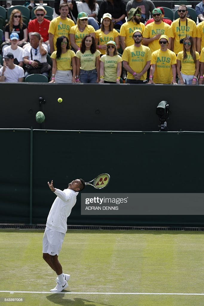 Australia's Nick Kyrgios warms up in front of the Australian fans for his men's singles first round match against Czech Republic's Radek Stepanek on the first day of the 2016 Wimbledon Championships at The All England Lawn Tennis Club in Wimbledon, southwest London, on June 28, 2016. / AFP / ADRIAN