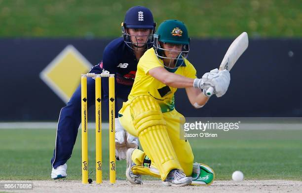 Australia's Nicole Bolton hits a shot as England's Sarah Taylor looks on during the Women's One Day International match between Australia and England...