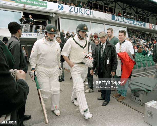 Australia's opening batsmen Mark Taylor and Mark Waugh walk out to open the batting during the 1st Texaco Trophy One Day International between...