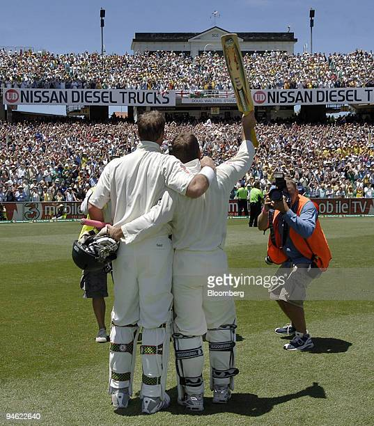 Australia's opening batsmen Mathew Hayden left and Justin Langer wave farewell to the crowd after Australia defeated England on day 4 of the fifth...