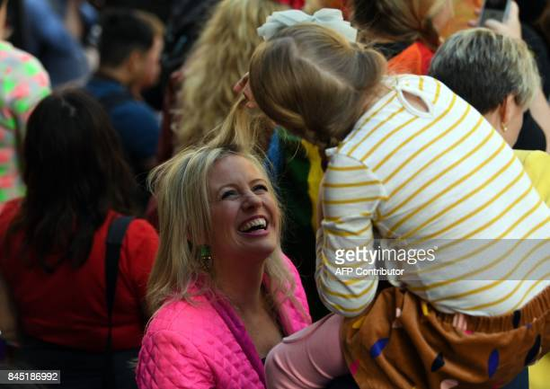Australia's opposition leader Bill Shorten's daugther Clementine plays with her mother Chloe's hair at a samesex marriage rally in Sydney on...