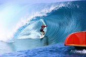 Australia's Owen Wright gestures as he rides a wave during the finale of the 14th edition of the Billabong Pro Tahiti surf event part of the ASP...