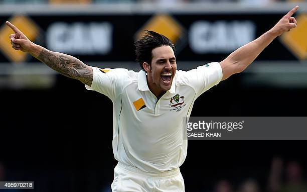 Australia's paceman Mitchell Johnson celebrates his wicket of New Zealand's batsman Ross Taylor during day two of the first Test cricket match...