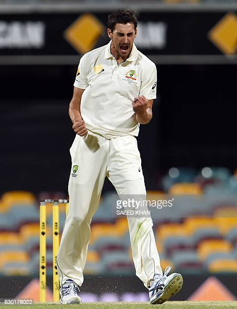 Australia's paceman Mitchell Starc celebrates his wicket of Pakistan's batsman Sarfraz Ahmed during the fourth day of the daynight cricket Test match...