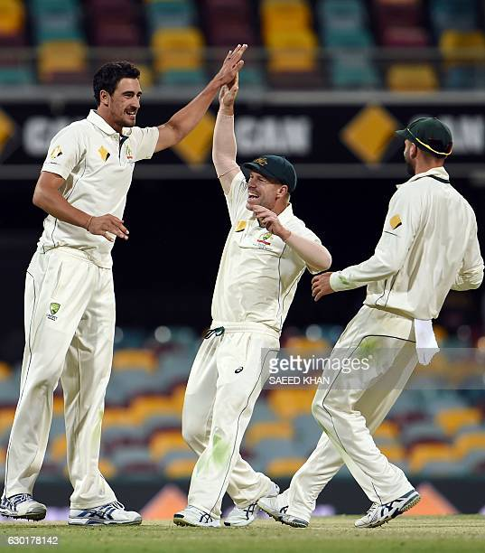 Australia's paceman Mitchell Starc celebrates his wicket of Pakistan's batsman Sarfraz Ahmed with teammates David Warner and Nathan Lyon during the...