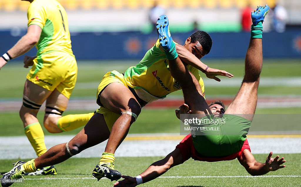 Australia's Pama Fou tackles Portugal's Duarte Moreira with out the ball after during their pool D match at the fourth leg of the IRB Sevens World Series in Wellington on February 1, 2013. AFP PHOTO / Marty MELVILLE