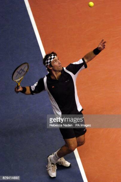 Australia's Pat Cash serves to France's Henri Leconte during the Masters tennis tournament at the Royal Albert Hall London