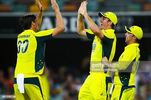 Australia's Pat Cummins Mitchell Marsh and Travis Head celebrate the dismissal of Pakistan's Mohammad Rizwan during the oneday international cricket...