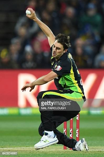 Australia's Pat Cummins slips while bowling during the second Twenty20 cricket match between Australia and Sri Lanka at Kardinia Park in Geelong on...