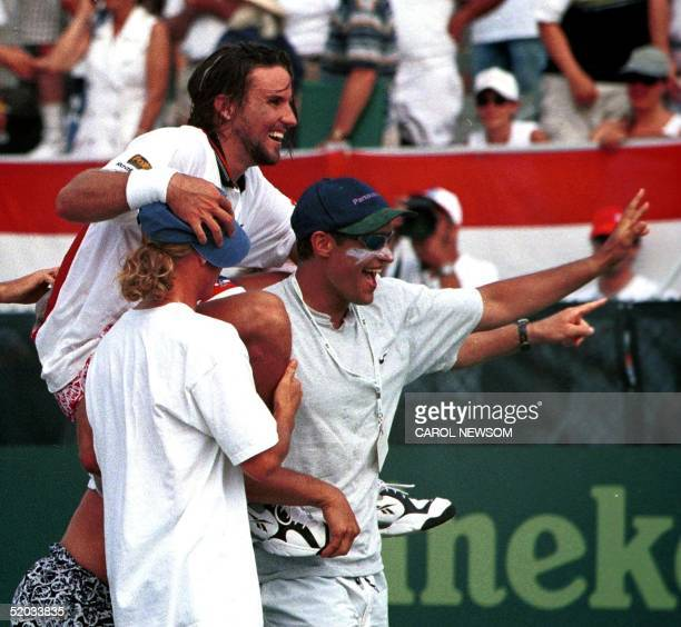 Australia's Patrick Rafter is carried off the courts by his Davis Cup teammates after his win over Todd Martin of the US won the title for the team...
