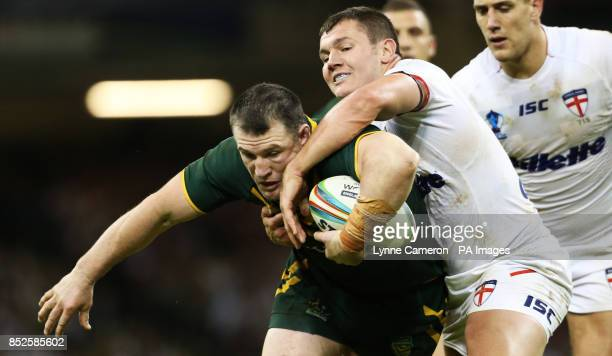Australia's Paul Gallen is tackled by England's Brett Ferres