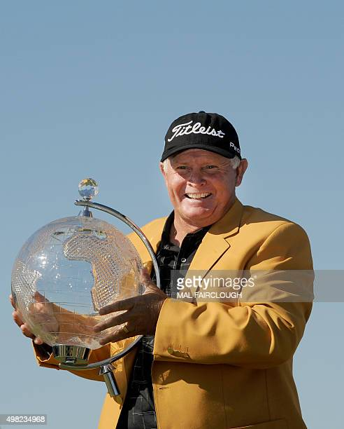 Australia's Peter Senior holds the championship trophy after winning the Australian Masters at Huntingdale Golf Club in Melbourne on November 22 2015...