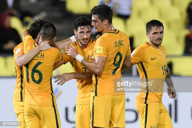 Australia's players celebrate a goal during the 2018 World Cup qualifying football match between Syria and Australia at the Hang Jebat Stadium in...