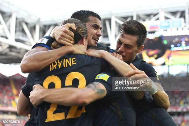 Australia's players celebrate after forward James Troisi scored during the 2017 Confederations Cup group B football match between Chile and Australia...