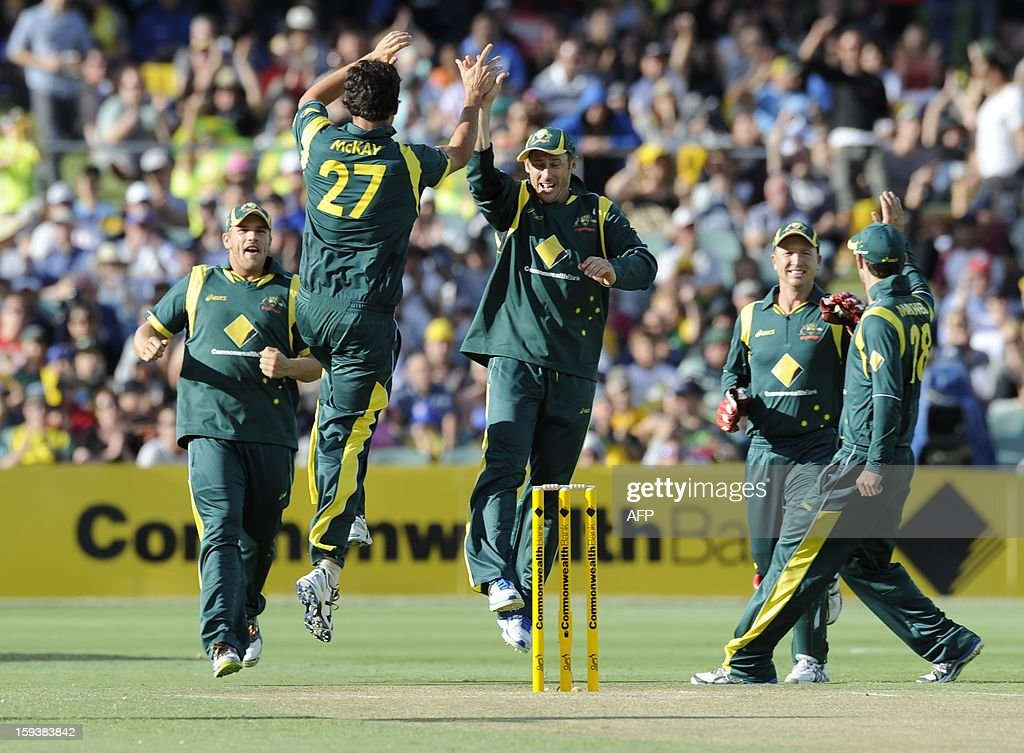 Australia's players celebrate the early dismissal of Sri Lanka's Upul Tharanga during their one-day international cricket match at the Adelaide Oval on January 13, 2013. AFP PHOTO / David Mariuz USE
