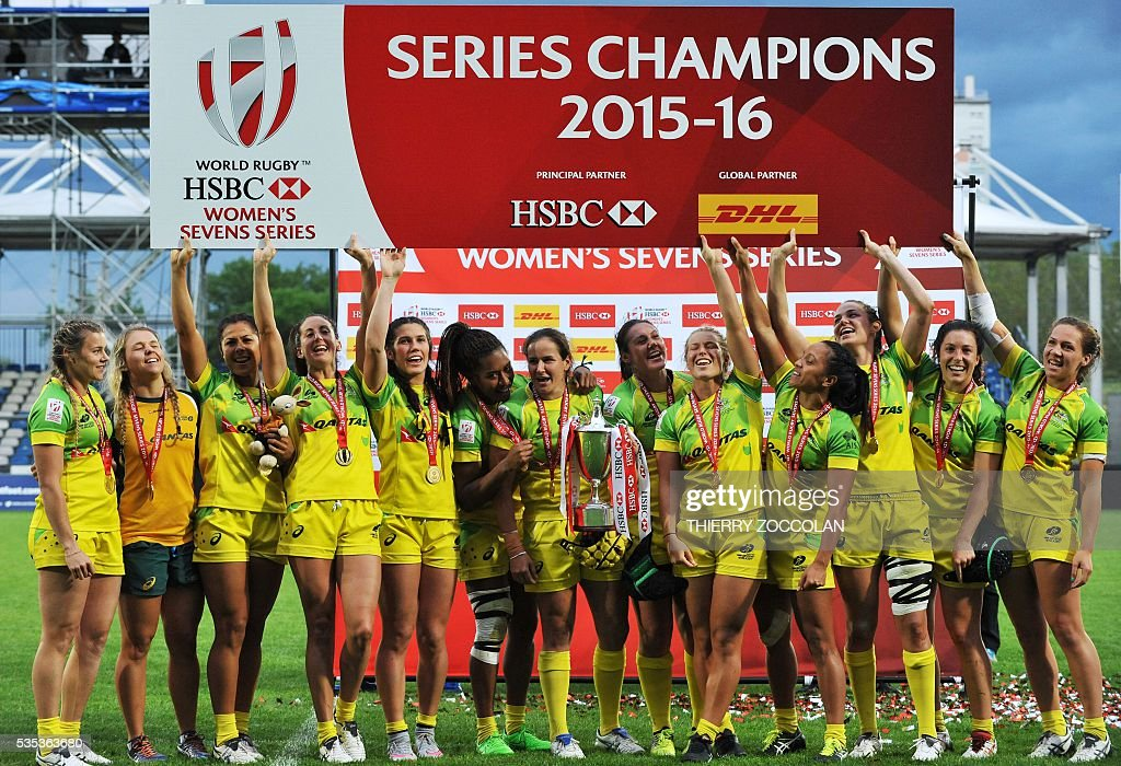 Australia's players celebrates after winning the World Rugby Women's Sevens Series final match between Australia and New Zealand on May 29, 2016 at the Gabriel Montpied stadium in Clermont-Ferrand, central France, on May 29, 2016.