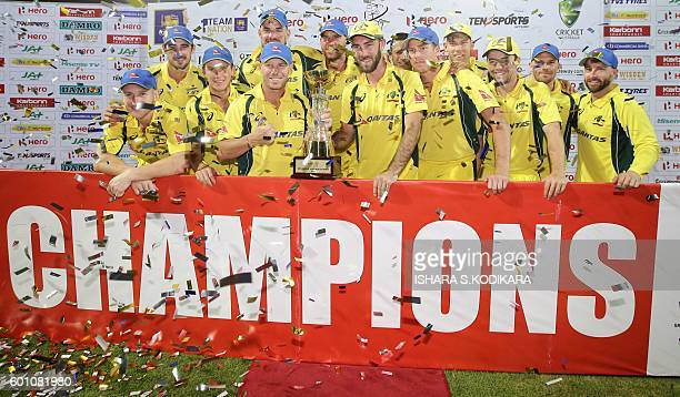 Australia's players pose after winning the final T20 international cricket match between Sri Lanka and Australia at the R Premadasa Cricket Stadium...