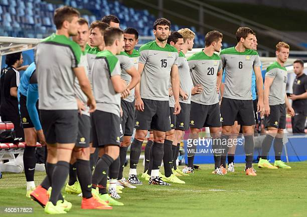 Australia's players train at the stadium in Cuiaba Brazil on June 12 ahead of their FIFA World Cup match against Chile to take place Friday AFP...