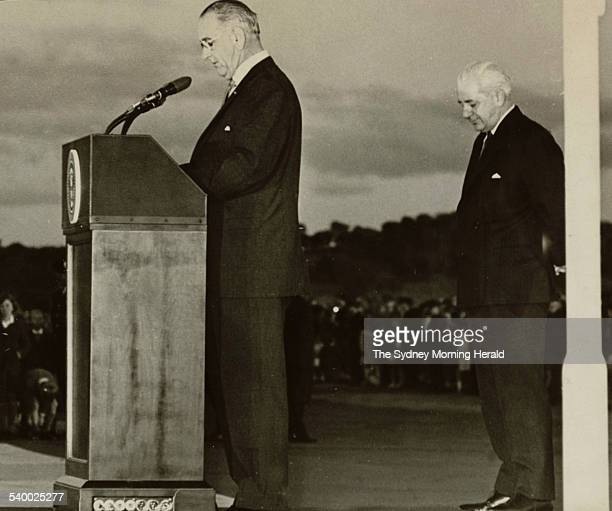 Australias Prime Minister Harold Holt listens as President Lyndon Johnson says on his arrival at Canberra that he had returned to Australia on a...