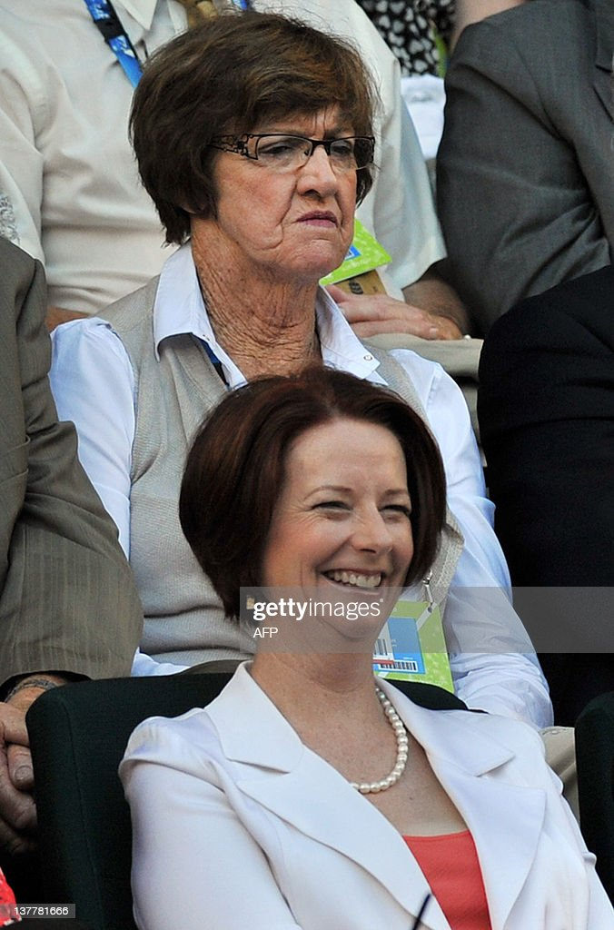 Australia's Prime Minister Julia Gillard (bottom) and Australian tennis legend Margaret Court (top) watch as Andy Murray of Britain plays against Novak Djokovic of Serbia in their men's singles semi-final match on day 12 at the Australian Open tennis tournament in Melbourne on January 27, 2012. IMAGE