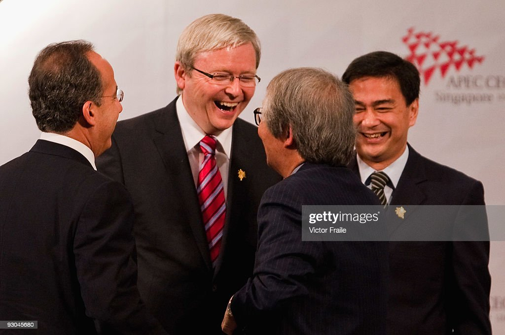 Australia's Prime Minister <a gi-track='captionPersonalityLinkClicked' href=/galleries/search?phrase=Kevin+Rudd&family=editorial&specificpeople=707751 ng-click='$event.stopPropagation()'>Kevin Rudd</a> (2ndL), Mexico's President <a gi-track='captionPersonalityLinkClicked' href=/galleries/search?phrase=Felipe+Calderon&family=editorial&specificpeople=534741 ng-click='$event.stopPropagation()'>Felipe Calderon</a> (L), Tommy Koh and Thailand's Prime Minester <a gi-track='captionPersonalityLinkClicked' href=/galleries/search?phrase=Abhisit+Vejjajiva&family=editorial&specificpeople=645779 ng-click='$event.stopPropagation()'>Abhisit Vejjajiva</a> (R) laugh during the second day of the Asia Pacific Economic Cooperation CEO Summit at Suntec Singapore International Convention & Exhibition Centre on November 14, 2009 in Singapore. APEC 2009 brings together 800 business leaders and 15 world leaders to Singapore, with the two-day Summit addressing the economic crisis and key global issues.