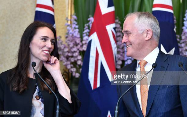 Australia's Prime Minister Malcolm Turnbull and his New Zealand counterpart Jacinda Ardern smile on a question during a joint press conference after...