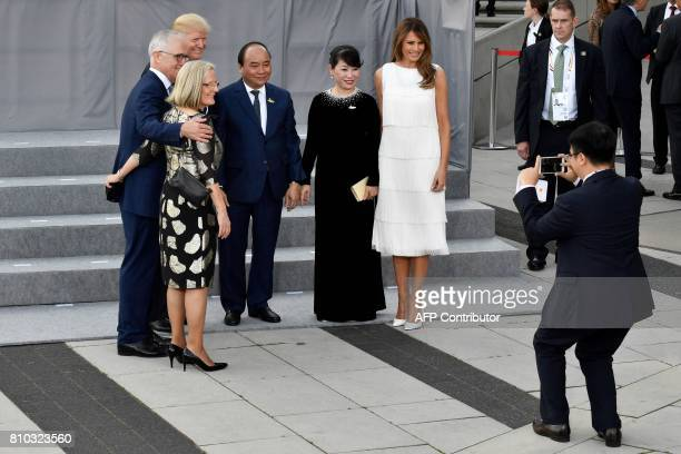 Australia's Prime Minister Malcolm Turnbull and his wife Lucy US President Donald Trump Vietnam's Prime Minister Nguyen Xuan Phuc and his wife Tran...