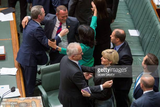 Australia's Prime Minister Malcolm Turnbull Foreign Minister Julie Bishop and other members of Parliament embrace after parliament passed the samesex...
