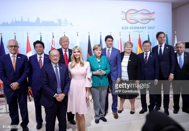Australia's Prime Minister Malcolm Turnbull Japan's Prime Minister Shinzo Abe World Bank Group President Jim Yong Kim US President Donald Trump his...
