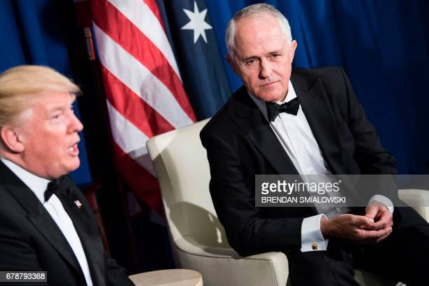 Australia's Prime Minister Malcolm Turnbull listens as US President Donald Trump makes a statement to the press before a meeting on board the...