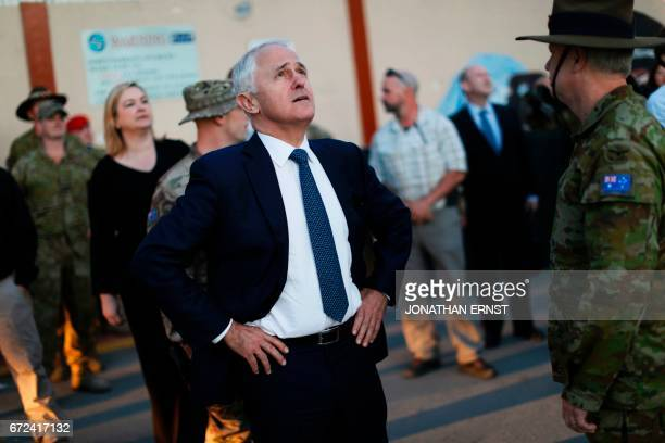 Australia's Prime Minister Malcolm Turnbull looks at an helicopter passing overhead at Resolute Support headquarters in Kabul on April 24 ahead of a...