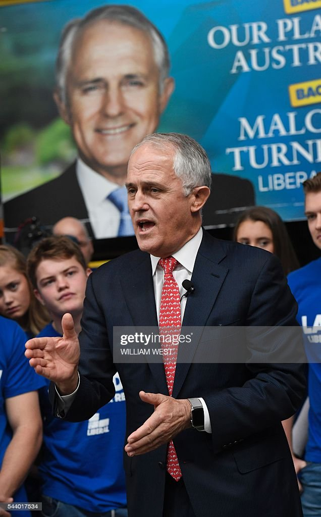 Australia's Prime Minister Malcolm Turnbull speaks at a campaign event in Sydney on July 1, 2016, as Australia's leaders make last-gasp pitches to wow voters with polls on the eve of elections pointing to a cliffhanger. Liberal Turnbull and Labor opposition leader Bill Shorten both opted to campaign in Sydney on their final day on the hustings as a poll in The Sydney Morning Herald showed them locked in a dead heat on a two-party basis. / AFP / WILLIAM