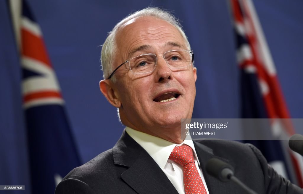 Australia's Prime Minister Malcolm Turnbull speaks at a press conference in Sydney on May 6, 2016, where he announced Singapore will invest up to 1.67 billion US dollars in Australia's defence infrastructure and hike the number of its troops training here as the nations deepen trade and defence ties. The agreement also includes commitments to open markets and trade and increased collaboration in science and research, Turnbull said, adding it would create thousands of jobs in northern Australia. / AFP / William WEST