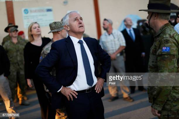 Australia's Prime Minister Malcolm Turnbull watches a helicopter passing overhead at Resolute Support headquarters April 24 2017 in in Kabul...
